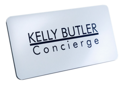 "A square and silver Engraved Name Badge with this leyend: ""Kelly Butler"""